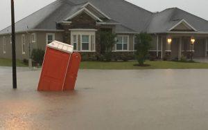 Suburban home on a flooding street