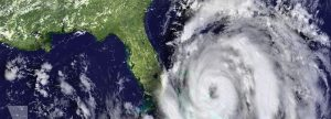 overview of large hurricane storm heading towards the eastern coast of Florida