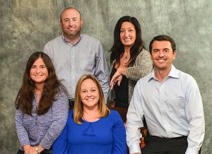 5 members of the Villages Insurance team