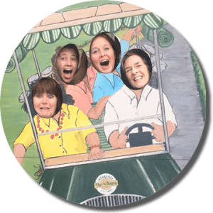 Cutout picture of a group in a golf cart, faces of people having fun in each of the cutout areas